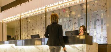 A woman checks into the lobby at Rodd Hotels & Resorts.